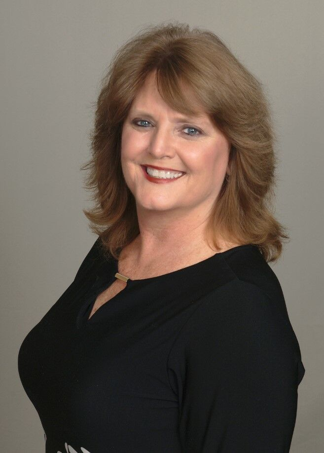 Tracy Dubay-Echols,  in Hernando Beach, Dennis Realty & Investment Corp.
