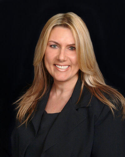 Theresa Perna,  in Hernando Beach, Dennis Realty & Investment Corp.