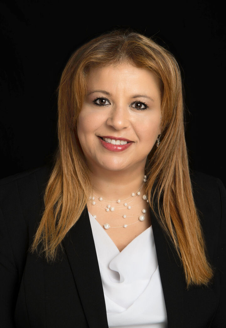Maria Pilar Garcia,  in Lutz, Dennis Realty & Investment Corp.